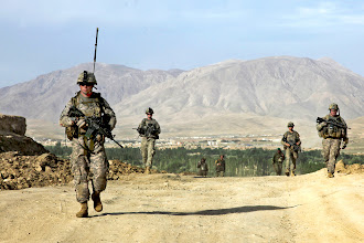 Photo: U.S. Army Sky Soldiers from 3rd Plt, Legion Company, 1-503rd Infantry Battalion, 173rd Airborne Brigade Combat Team as well as Afghan National Army soldiers walk down a road while traveling back from the village of Naeban, Nerkh District, Wardak province, Afghanistan, May 27. These soldiers went to the village primary school in order to drop off some school supplies and to check up on conditions in the area.