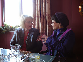 Photo: Mary demonstrates to Celia her knowledge of sign language