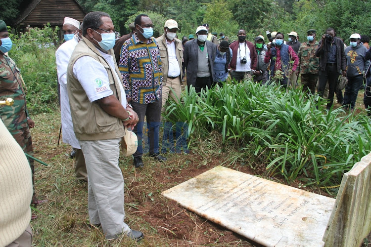 Environment CS Keriako Tobiko pays a tribute to freedom fighter Pio Gama Pinto at the Goan Cemetery on the International Day to Combat Desertification and Drought at Nairobi City Park on June 17,2020