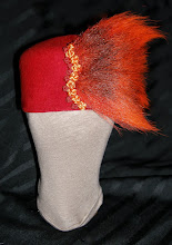 Photo: <KAPELUXE> Unique-Chique Hats by Luba Bilash ART & ADORNMENT  <Phoenix/Жар-птиця> Tomato red wool felt base, red & marigold Chinese knots, dyed orange deer tail, 360 degree possibilities. Can also be worn on an angle. Size L - 56 cm/22 in $85 SOLD