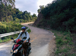 Photo: The next day Laurie and I rented 4-cycle mopeds and explored Koh Lanta. Motorcycling is fun!