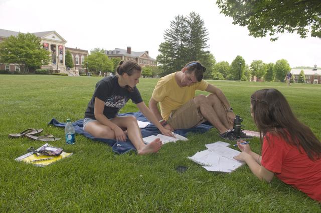 Photo: Freshmen Brittany Peddicord, Bryan Bailey and Victoria Poletis study for exams on the main lawn.