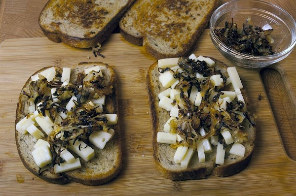 Take half the caramelized onions, and spread over the cheese.
