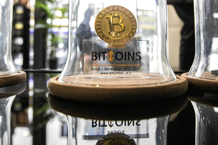 A bitcoin on display at La Maison du Bitcoin bank in Paris.