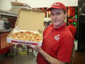 Photo: Pepperoni & Sausage. I love this pizza topping combo,  and seem to always want to take a photo with it!  And add the bacon and Ham and you have my meat Luvers Pie.  Enjoy,  Jim Hofman Owner/Operator/Pizza Inspector for 20 years strong this coming 2012 season!  www.JimHofman.com