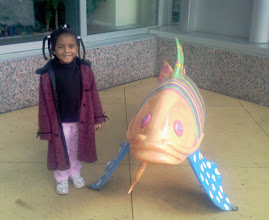 Photo: Kaleya w/ the fish statue on campus - dec 2008