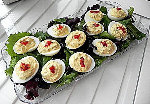 Fill your sliced eggs with mixture and top with slivers of sun-dried tomatoes.