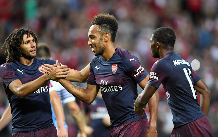 Arsenal's Pierre-Emerick Aubameyang celebrates scoring their second goal with Mohamed Elneny and Ainsley Maitland-Niles.