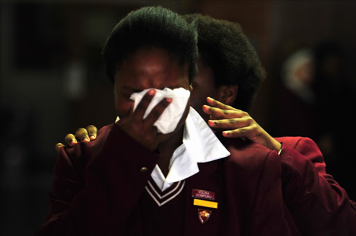 Pupils and fellow teachers of Riebeek College Girls High School reel with shock at the announcement that the body of Jayde Panayiotou was found on April 22, 2015 in Port Elizabeth, South Africa.
