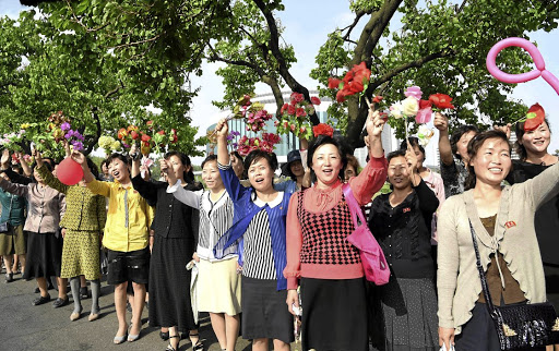 People cheer as developers of the ground-to-ground medium-to-long range strategic ballistic rocket Hwasong-12 arrive in Pyongyang, in this undated photo released by North Korea's Korean Central News Agency (KCNA), in Pyongyang on May 19 2017. Picture: KCNA VIA REUTERS