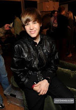 """Photo: HOLLYWOOD - FEBRUARY 01:  Musician Justin Bieber attends the """"We Are The World 25 Years for Haiti"""" recording session held at Jim Henson Studios on February 1, 2010 in Hollywood, California.  (Photo by Kevin Mazur/WireImage)"""