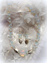 Photo: # 219 Moonstone, sterling silver, silver plate $130