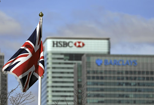 The Union Jack flies in front of the HSBC Holdings and Barclays headquarters in London.  Picture: BLOOMBERG