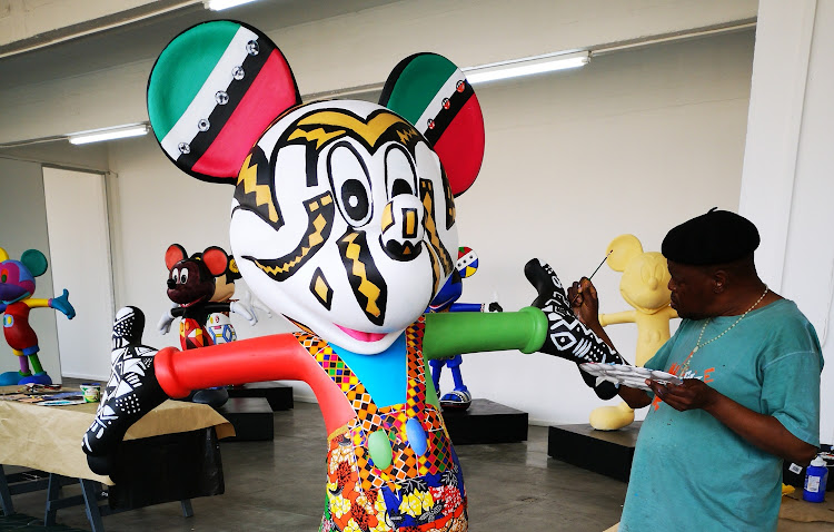 Artist Dominic Tshabangu adds the finishing touches to his Mickey statue, which he says reflects a mix of 'contemporary sensibilities and African traditional patterns'.