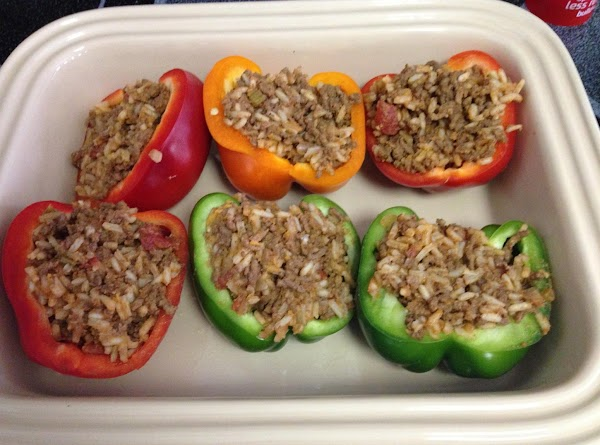 Stuff the peppers with the rice mixture and place them in a baking dish....