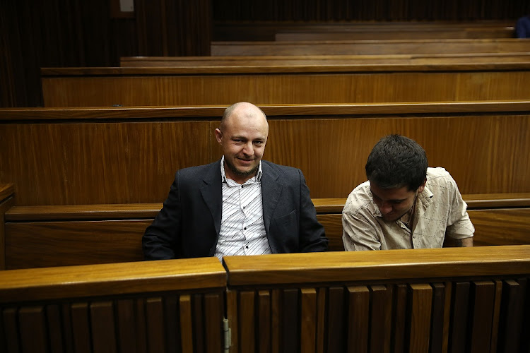Zac Valentine, Le Roux Steyn (Pictured) are part of a group of six people accused of carrying out 11 vicious murders' are seen in the High Court in Johannesburg.