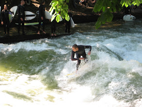 Photo: Englisher Garden has an artificial river with surf-able waves at its origin.