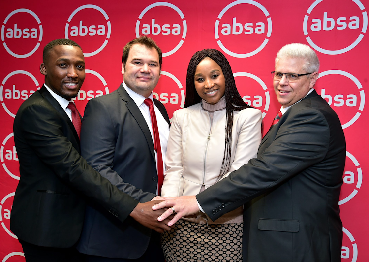 Joining hands to signify a new partnership for The Herald Absa Matric of the Year with The Herald and Weekend Post editor Nwabisa Makunga are Absa officials, from left, Thabiso Yako, Frikkie Coetzee and Johnny Alcock.