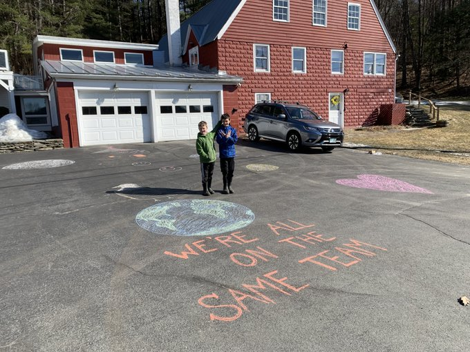 brothers outside wrote oin pavement - we're on the same team