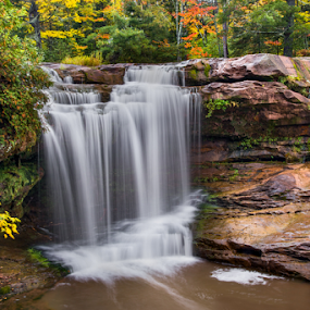 O Kun de Kun Falls Autumn by Kenneth Keifer - Landscapes Waterscapes ( waterfall, rock, remote, blur, leaves, landscape, nature, autumn, foliage, long exposure, water, ontanagon, flowing, cliff, midwest, ontanagon county, forest, scenic, plunging, plunge, o kun de kun, woods, rural, blurred, upper peninsula, michigan, splashing, color, fall, o kun de kun falls, baltimore river, trees, cataract, october, whitewater )