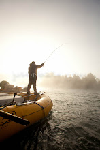 Photo: Young man fly fishing while on a whitewater raft trip on the Chilko River. British Columbia, Canada.