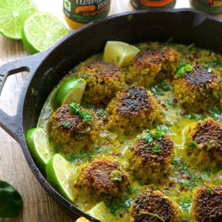 Cauliflower Quinoa Meatless Meatballs In Coconut Turmeric Sauce.