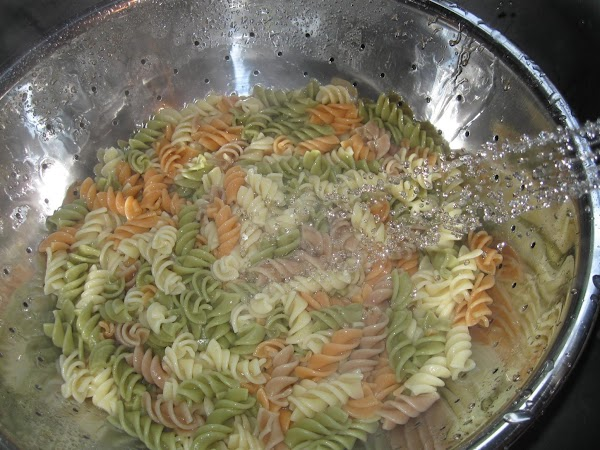 Cook pasta per directions. When done, pour into colander and spray with cold water...