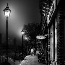 Evening Walk by John Finch - Black & White Street & Candid ( sidewalk, street scene, lamp posts, black and white, night scene )