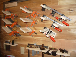 Photo: The smaller clamps are mostly stored on the wall behind one of the workbenches...