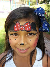 Photo: Minnie Mouse face paint design by Tess, Glendora, Ca. Call to Book Tess at 888-750-7024