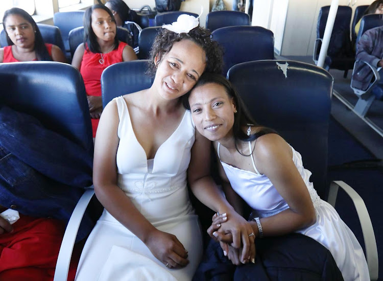 Marcia Jumat and Rozeana Julius aboard the ferry Sikhululekile on their way to get married on Robben Island on February 14 2019.
