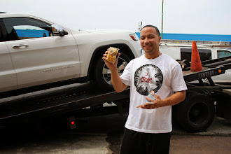 Photo: Getting you car towed isn't fun, but some complimentary Garrett Mix definitely helped cheer him up!