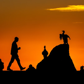 Morecambe sunset by Brad Cheek - City,  Street & Park  Street Scenes ( sculpture, statue, walking, silhouette, sunset, colouts, people, morecambe, birds )