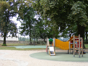 Photo: The park contains a large children's play area. The structure for younger children in the foreground seems normal enough, but I wonder if the climbing ropes in the rear would ever be found in the litigation-happy US.