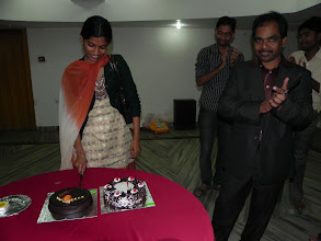 Photo: Dr. Mahapatra's younger daughter does the honours...