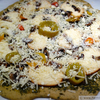 Smoked Mozzarella, Feta, Mushroom and Pickled Pepper Pesto Pizza.