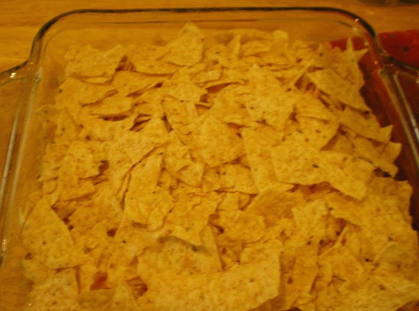 Top with the rest of the tortilla chips or corn tortillas.