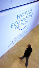 Photo: DAVOS/SWITZERLAND, 24JAN12 - A staff member looks at the logo of the World Economic Forum ahead of the upcoming Annual Meeting 2012  in Davos, Switzerland, January 24, 2012.Copyright by World Economic Forumswiss-image.ch/Photo by Moritz Hager