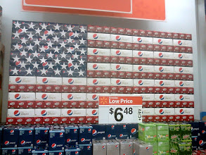 Photo: This flag made from soda boxes was on display right when I walked in, I thought it looked pretty cool.