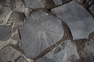 Photo: Тротуар у храма отделан обломками из базальтового каньона
