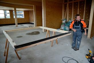 Photo: 20-11-2012 © ervanofoto Het kader van de inkomdeur ligt klaar voor de plaatsing.