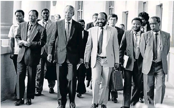 Nelson Mandela leads a delegation of the ANC at the Union Buildings in the 1990s . With him are Jacob Zuma (with Mandela's briefcase), Saki Macozoma and Joe Nhlanhla. Jay Naidoo and Alec Erwin can be seen in the background
