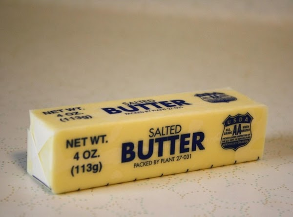 Butter a baking sheet.Butter each piece of corn.  Place corn on baking sheet.Spinkle...