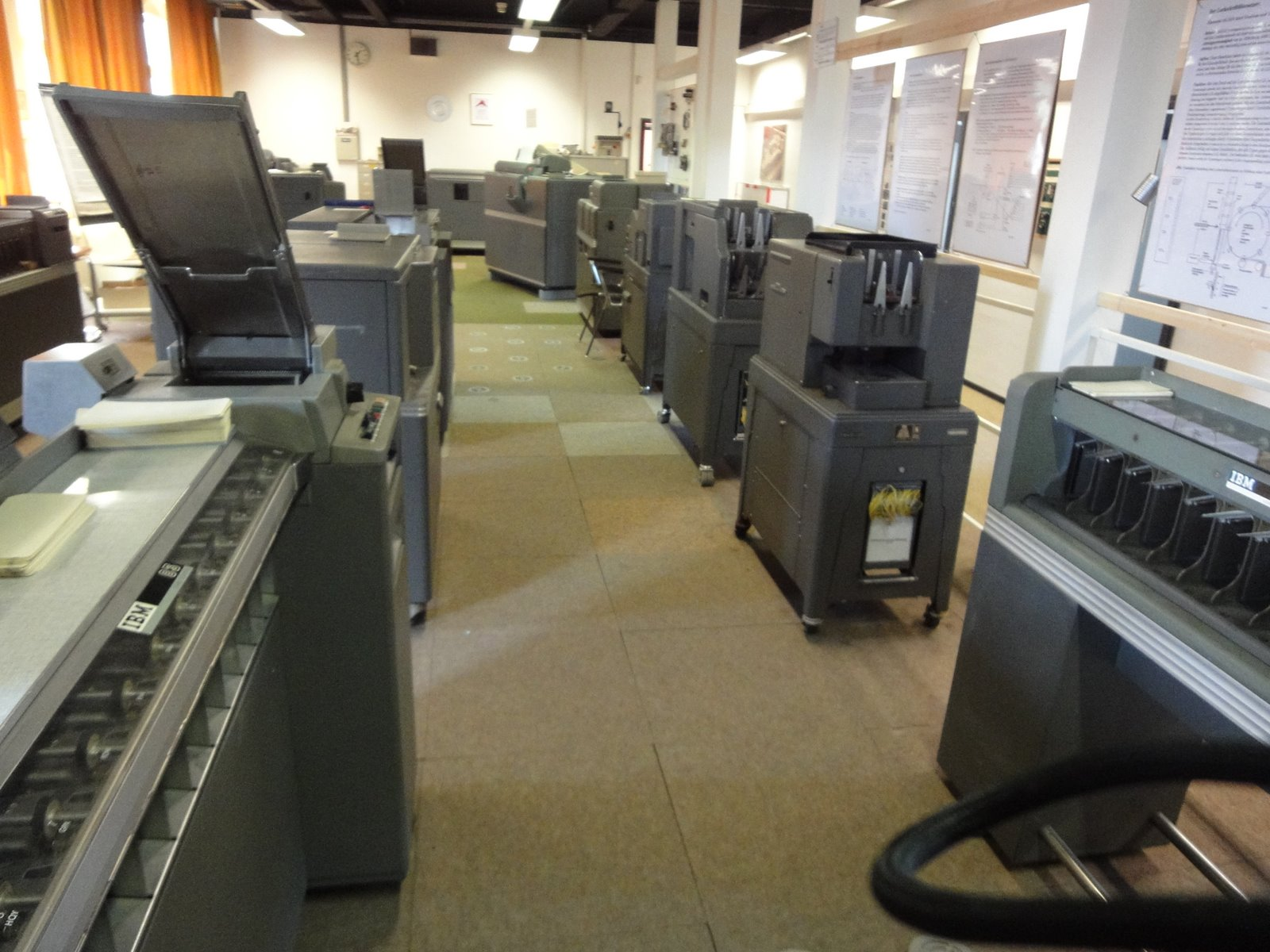 Photo: Front to back left: Sorter, What?, Collator. Right: Sorter, Reproducing punches, Interpreters, 422 accounting machine .