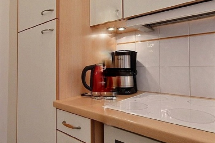 Kitchen at 1 Bedroom Serviced Apartment in Louvre Street