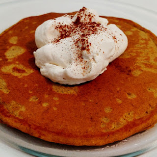 Pumpkin Pancakes with Whipped Cream.