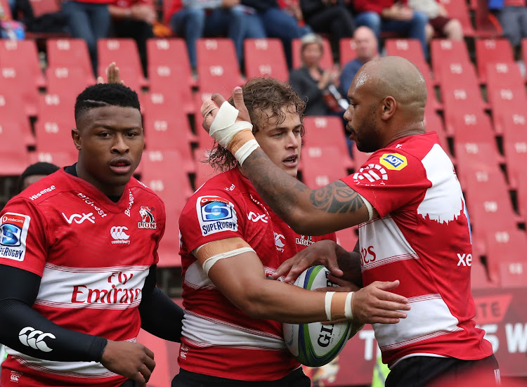 Andries Coetzee of the Lions (c) celebrates a try with teammate Lionel Mapoe (r) during the 2018 Super Rugby match between the Lions and the Sunwolves at Ellis Park, Johannesburg on 17 March 2018.