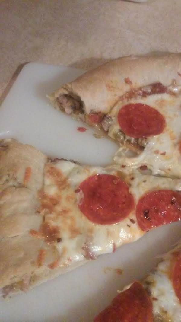 Pizza With Pork And Green Chili Stuffed Crust.