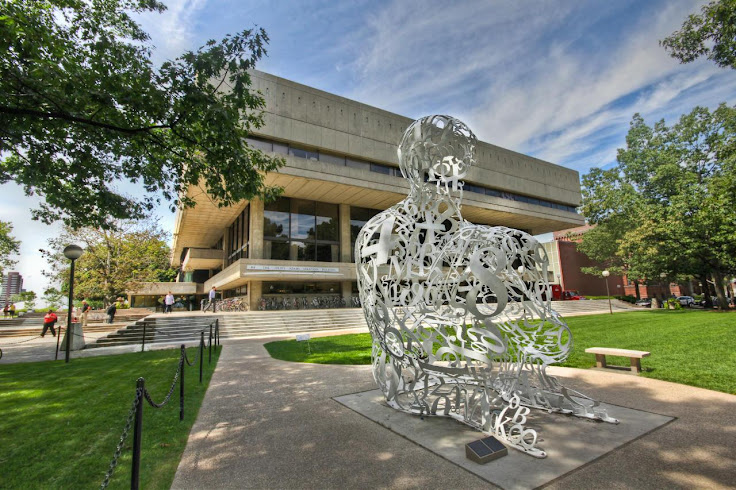 """The Alchemist"" by Jaume Plensa in front of the Stratton Student Center."
