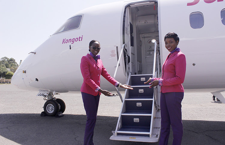 Cabin crew Janet Sophie and Irene Oyier during the unveiling of the new De Havilland Dash 8-Q400 Aircraft.